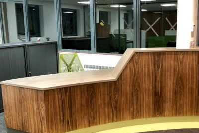 Beautiful Walnut and Corian reception desk